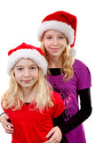 Two girls with chriastmas hat. Two girls with christmas hat over white background Royalty Free Stock Photos