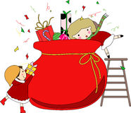 Two girls and christmas bag with gifts Royalty Free Stock Image