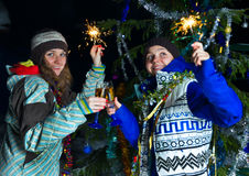 Two girls with Christmas champagne outdoors Royalty Free Stock Images