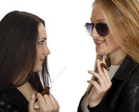 Two girls with cigarettes Stock Image