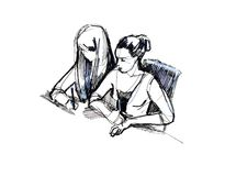 Two girls in the classroom at a desk Stock Photos