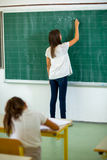 Two girls in the classroom Royalty Free Stock Image
