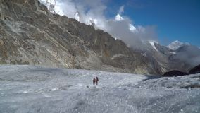 Girls mountaineers in the Himalayas. Two girls climbers go through the glacier in the Himalayas. Nepal. 4K stock footage