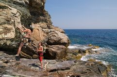 Two girls climbing. On the cliff Royalty Free Stock Photo
