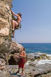 Two girls climbing. On the cliff Royalty Free Stock Images