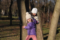 Two girls. Climbing in trees stock photography