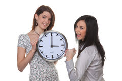 Two girls with a clock Royalty Free Stock Image