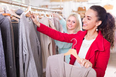 Two girls at clothing store Royalty Free Stock Images