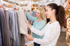 Two girls at clothing store Stock Photo