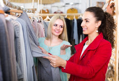 Two girls at clothing store Royalty Free Stock Image
