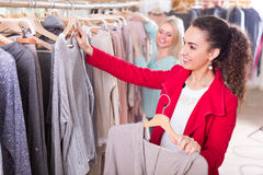 Two girls at clothing store Stock Images