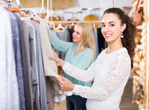 Two girls at clothing store Royalty Free Stock Photo