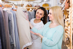 Two girls at clothing store Stock Photos