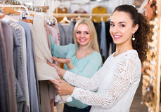 Two girls at clothing store Stock Image