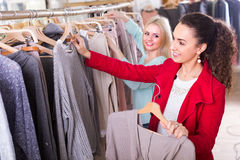 Two girls at clothing store Royalty Free Stock Photography