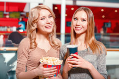 Two girls with coke and popcorn Stock Photos