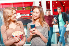 Two girls with coke and popcorn Stock Photo
