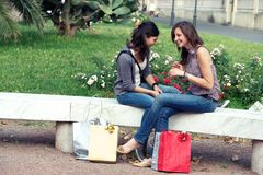 Two girls with colored bags outdoor Stock Images