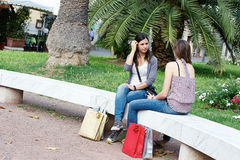 Two girls with colored bags outdoor Royalty Free Stock Image