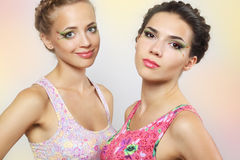 Two girls with colored make-up Stock Images