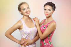 Two girls with colored make-up Royalty Free Stock Images