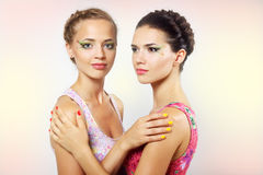 Two girls with colored make-up Royalty Free Stock Photo