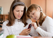 Two girls communicating in classroom Royalty Free Stock Photo