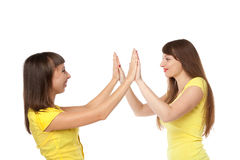 Two girls communicating among themselves. Two young beautiful girls communicating among themselves  on a white background Royalty Free Stock Image