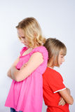 Two girls in conflict standing back to back Royalty Free Stock Photos
