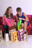 Two girls consider and show each other purchases Royalty Free Stock Photo