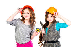 Two girls in construction helmets Royalty Free Stock Images