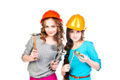 Two girls in construction helmets Stock Photos