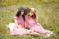 Two girls at contryside. Royalty Free Stock Photos
