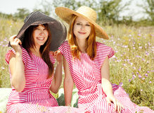Two girls at contryside. Royalty Free Stock Images