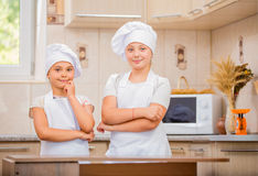 Two girls cook Stock Image