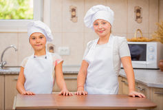 Two girls cook Stock Photography