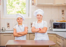 Two girls cook Stock Photos