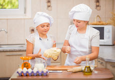 Two girls cook Royalty Free Stock Photography
