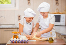 Two girls cook Stock Photo