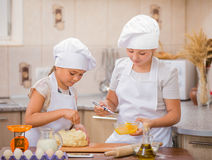 Two girls cook Royalty Free Stock Photo