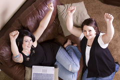Two Girls on the Couch Shopping Online Stock Photo
