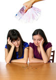 Two girls count their money Stock Photography