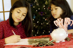 Two girls counting their money Royalty Free Stock Image