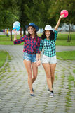 Two girls in cowboy hats with balloons Royalty Free Stock Photos