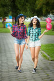 Two girls in cowboy hats with balloons Stock Images