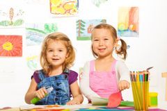 Two girls on craft lesson Stock Photos
