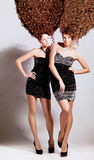 Two girls with curly hairstyle Royalty Free Stock Photos