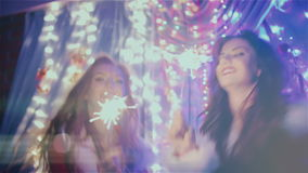 Two girls dancing with Christmas lights