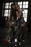 Two girls dancing with disco ball at abandoned house Stock Photo
