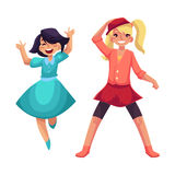 Two girls dancing at party, blue dress, skirt and leggings Stock Photography